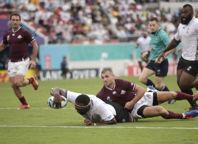 Fiji's Api Ratuniyarawa reaches out to score try during the Pool D game.