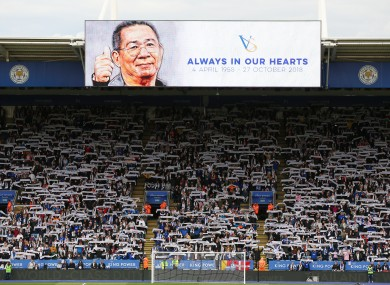 Fans observe a minute's silence in memory of former Leicester City chairman Vichai Srivaddhanaprabha.