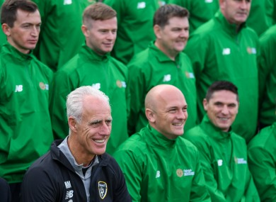 Mick McCarthy alongside Irish Defence Forces manager Richie Barber and his players.