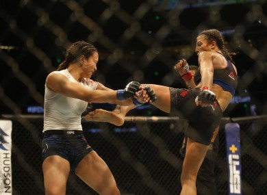 Jedrzejczyk aims a kick at Waterson during their top-billed bout in Tampa.
