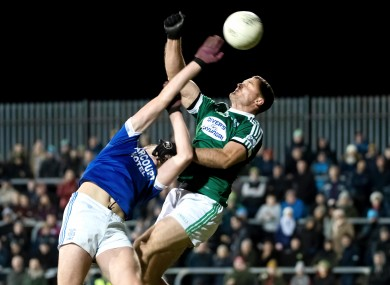Gweedore's Niall MacAoidh and Naomh Conaill's Charles McGuinness compete for a high ball.