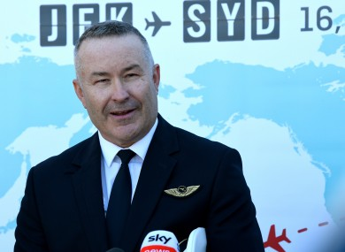 Qantas Captain Sean Golding speaks to the media during a press conference at Sydney International Airport.