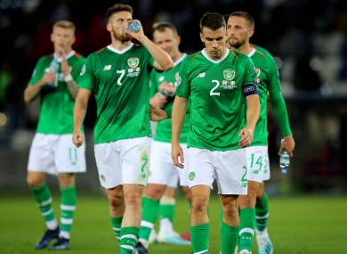 Irish players leave the field after the draw with Georgia.
