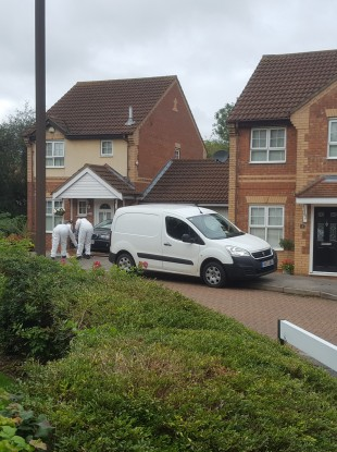 Forensic police at the housing estate in Emerson Valley, Milton Keynes, where the teenage boys were stabbed to death last night.