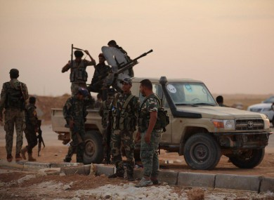 Syrian government forces enter the Al-Tabqa airbase south of Syria's Raqqa region today.