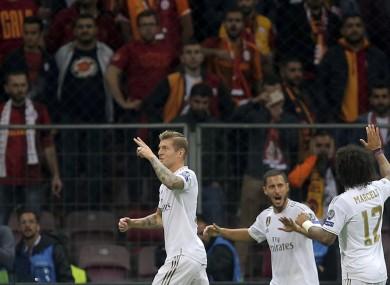 Real Madrid's Toni Kroos, left, celebrates with teammates.