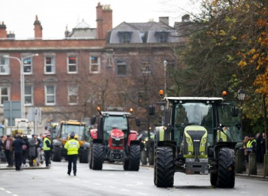 Farmers arrive along St Stephen's Green.