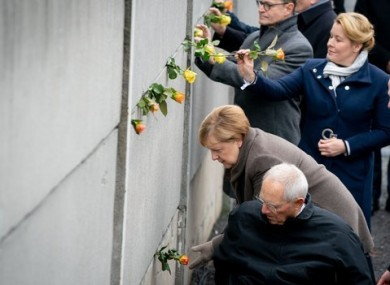 Angela Merkel at a part of the former Berlin Wall today.