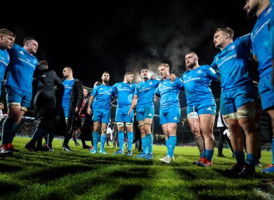 The Leinster team form a huddle following their win in Lyon.