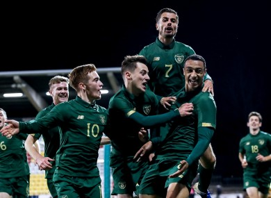 Ireland players celebrate a goal.