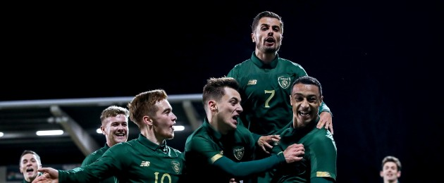 Ireland players celebrate a goal.