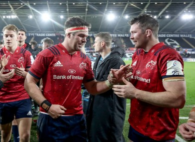 Billy Holland and Peter O'Mahony celebrate post-match.