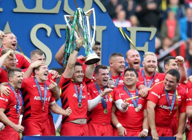 Saracens' Brad Barritt lifts the Heineken Champions Cup after their win over Leinster.