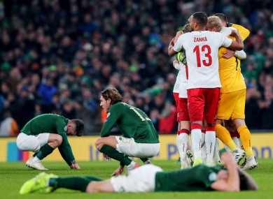 Ireland players show their disappointment as the Danes celebrate.