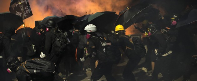 Students use umbrellas as a shields during a clash with police at the Chinese University in Hong Kong on Tuesday.