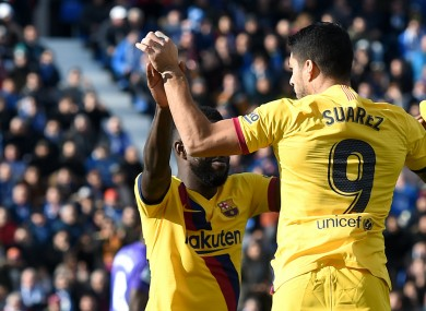Barcelona striker Luis Suarez celebrates.
