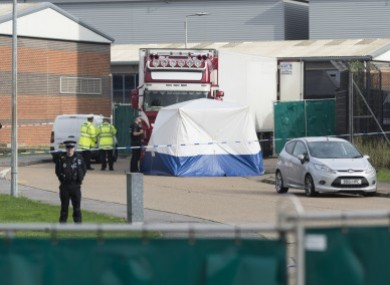 Police officers work at the scene where 39 bodies were found in a shipping container at Waterglade Industrial Park in Essex.