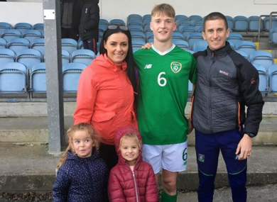 Cathal pictured with his parents and sisters.