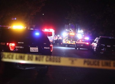 Police and emergency vehicles at the scene of the shooting in Fresno, California