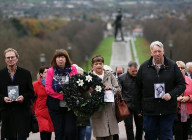 Oliver McVeigh (right) and his sister Dympna Kerr (second left), brother and sister of Columba McVeigh, along with Marie Lynskey, niece of Joe Lynskey, and Mike Pywell, carrying a photograph of Robert Nairac, the three men who's remains are yet to be recovered,