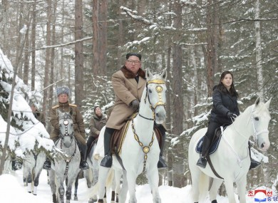 Kim Jong Un,with his wife Ri Sol Ju riding on white horses during a visit to Mount Paektu, North Korea.