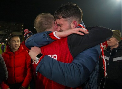 An Éire Óg fan celebrates their Leinster semi-final win with manager Joe Murphy.