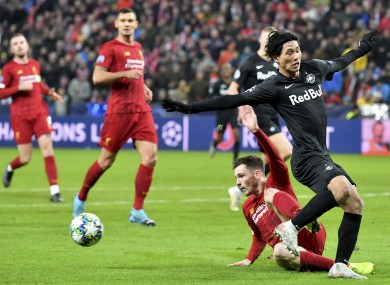 Takumi Minamino tackled by Andy Roberston in last week's Champions League game.