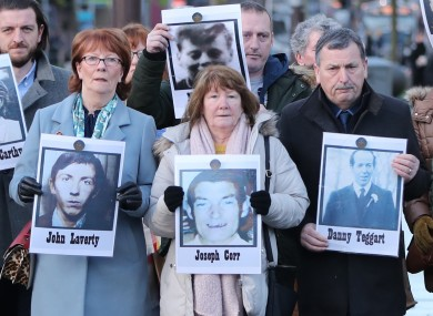 Family members outside Laganside Courts in Belfast today holding images of some of those who were killed.