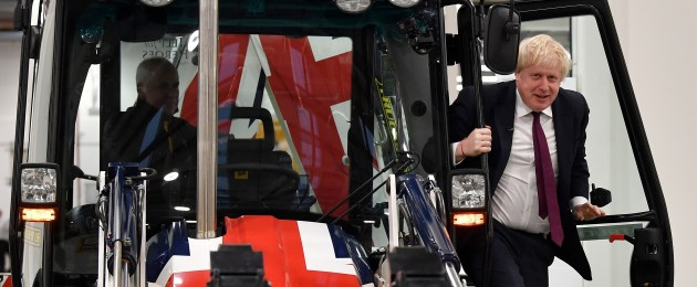 Prime Minister Boris Johnson in a Union Jack-themed JCB today.