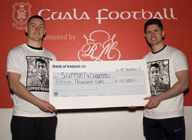 Con O'Callaghan and Conor Mullally with the cheque.