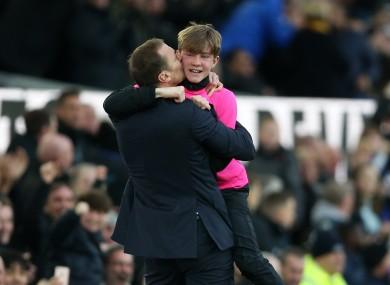 Everton caretaker manager Duncan Ferguson celebrates with a ball boy.