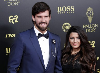 Liverpool's goalkeeper Alisson Becker poses with his wife Natalia Loewe during the Golden Ball award ceremony.