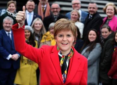 Nicola Sturgeon celebrates with her MPs after last week's election victory.
