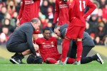 Georginio Wijnaldum receives treatment after being injured against Watford.
