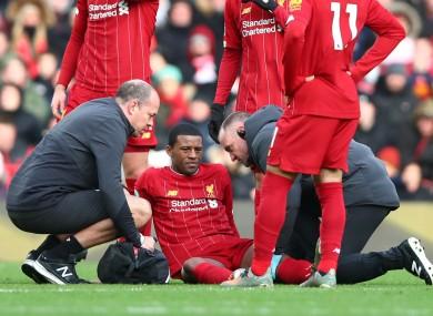 Georginio Wijnaldum receives treatment after being injured against Watford.