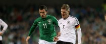 Ireland's Keith Fahey tangling with Bastian Schweinsteiger of Germany during a 2014 World Cup qualifier.