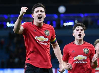 Harry Maguire leads Man Utd's celebrations after their derby victory.