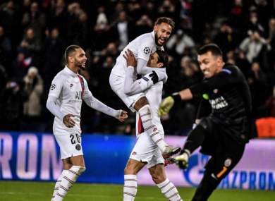 Neymar and Edinson Cavani celebrate Paris Saint-Germain's fifth goal against Galatasaray.