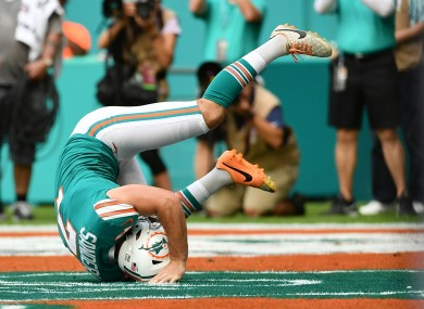 Miami Dolphins kicker Jason Sanders tumbles after making a catch for a touchdown against the Philadelphia Eagles.