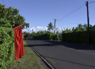 A red flags hangs outside the home of residents who have not been vaccinated in Apia, Samoa, today