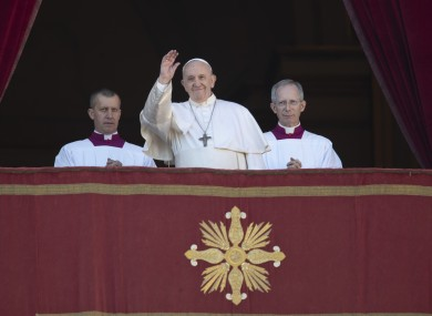 Pope Francis waves to faithful and pilgrims after he delivered the Urbi et Orbi
