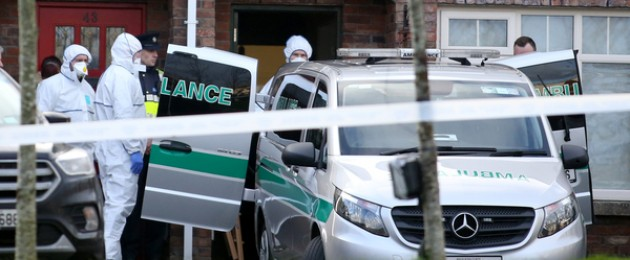 An ambulance taking away the bodies of three children from a house in Newcastle this morning.
