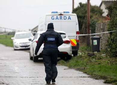 Garda search teams in a lane behind a house as they continued a detailed examination of a house and the surrounding wasteland in the Rathmullen Park area in Drogheda