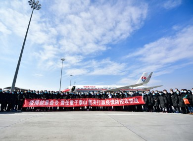 Members of a medical team pose for a group photo before their departure to Wuhan of Hubei Province in Xining, northwest China.