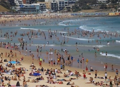 Crowds of people are seen at Bondi Beach on Christmas Day in Sydney.