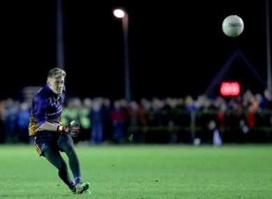 Evan Comerford kicking a free for DCU.