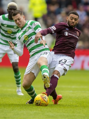 Celtic's Callum McGregor tangles with Jake Mulraney of Hearts.