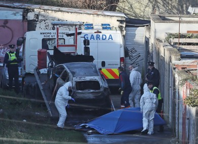 A burnt out car which contained human remains, believed to be linked to the disappearance of a 17-year-old boy from Co Louth, is removed from the scene on Trinity Terrace in the Drumcondra area of Dublin.