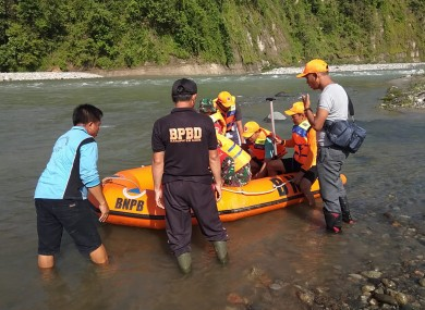 A rescue team prepare to search for victims of a bridge collapse in Kaur, Indonesia