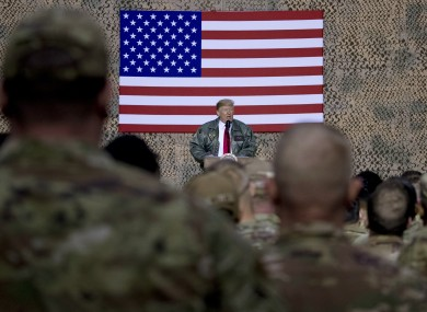 President Donald Trump speaks at a hanger rally at the Al Asad Air Base in Iraq, one of those targeted overnight.